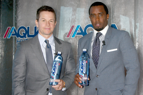 Sean Combs and Mark Wahlberg pose with water
